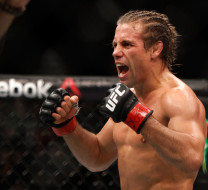 Urijah Faber and Frankie Saenz in their bantamweight fight during UFC 194 on December 12, 2015 in Las Vegas, Nevada.