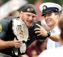 CLEVELAND, OH - JUNE 22:  UFC heavyweight champion Stipe Miocic takes a photo with a fan during the Cleveland Cavaliers 2016 NBA Championship victory parade and rally on June 22, 2016 in Cleveland, Ohio.  (Photo by Mike Lawrie/Getty Images)