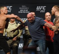 LAS VEGAS, NV - AUGUST 19:  UFC President Dana White (C) separates mixed martial artist Nate Diaz (L) and UFC featherweight champion Conor McGregor (R) as they face off during their weigh-in for UFC 202 at MGM Grand Conference Center on August 19, 2016 in Las Vegas, Nevada. The fighters will meet in a welterweight rematch on August 20, 2016, at T-Mobile Arena in Las Vegas.  (Photo by Ethan Miller/Getty Images)